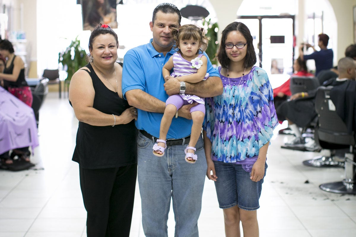 Daniel Montalvo, with his wife, Marina, and two daughters, does not have insurance. He is a manager at Salon Hispano in Woodbridge,             Va., and is shopping around for coverage.