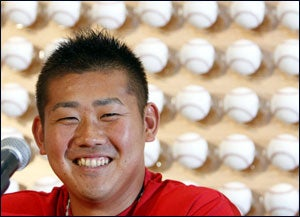 Red Sox pitcher Daisuke Matsuzaka of Japan laughs as he answers a question at a news conference in Newport Beach, California January 31, 2007.