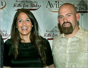 Red Sox Kevin Youkilis Hits for Kids celebrates it's first year, he raised over 800,000 dollars, the event was held at Avila Restaurant in Park Sq. left to right are Enza Sambataro and Kevin Youkilis