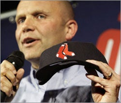 Red Sox chief operating officer Mike Dee holds up the new secondary