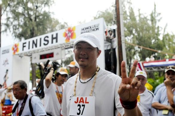 Red Sox pitcher Hideki Okajima gestures after finishing the Honolulu Marathon on Sunday in Honolulu.