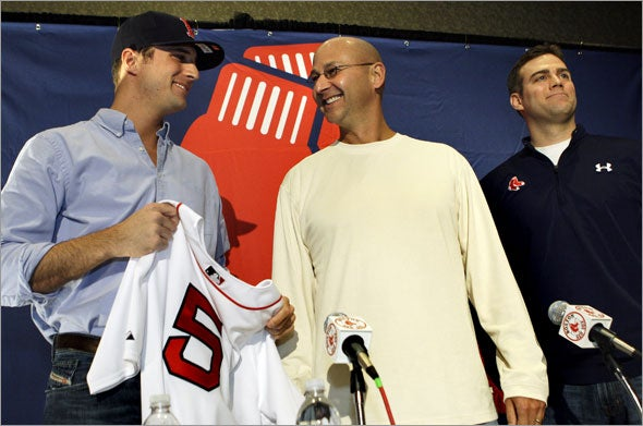 Newly acquired Boston Red Sox Rocco Baldelli smiles as he receives his jersey and cap from manager Terry Francona, middle, and general manager Theo Epstein, right, at a news conference in Boston on Thursday, Jan. 8, 2009.