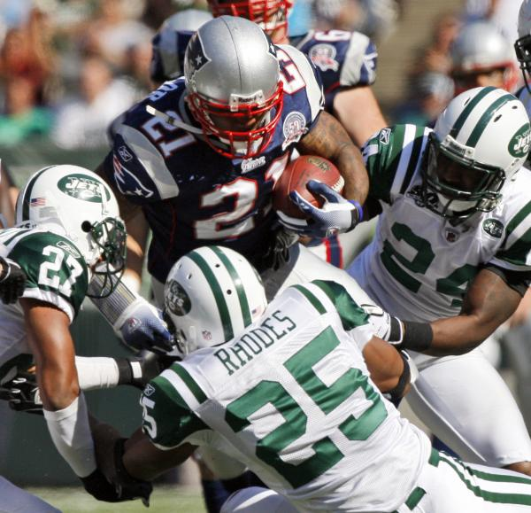 running-back-fred-taylor-of-the-patriots-is-tackled-by-the-jets-kerry-rhodes-and-darrelle-revis.jpg