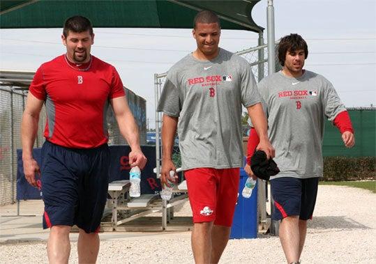 Jason Varitek, Victor Martinez, and Dusty Brown walk off the field