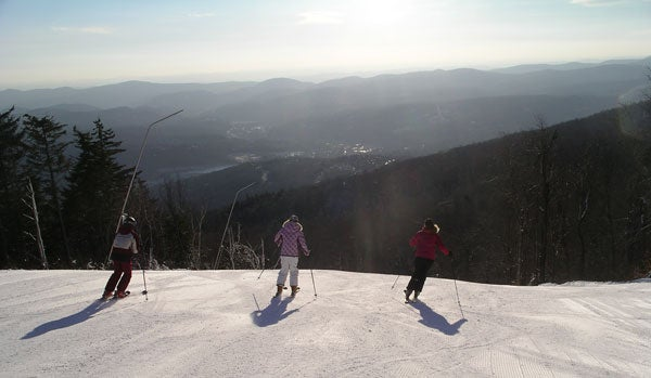 okemo_sunrise_skiers.jpg