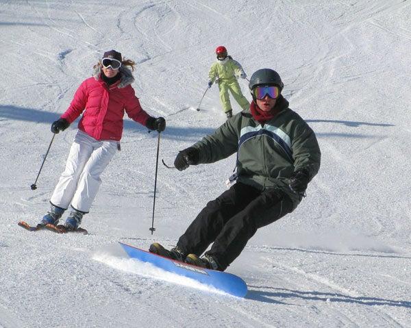 women-skiing-snowboarding.jpg