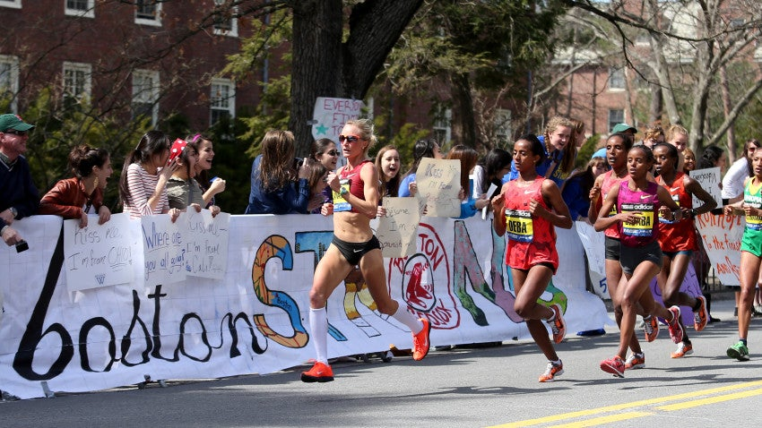 Shalane Flanagan leads Buzunesh Deba, of Ethiopia, and Mare Dibaba, of Ethiopia, and the elite pack past Wellesley College. Flanagan still led as the runners passed the 25K mark of the race.