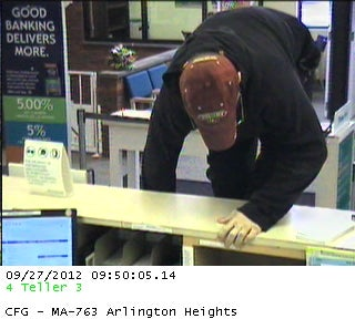 A bank surveillance camera captured this image of the man climbing over the counter.