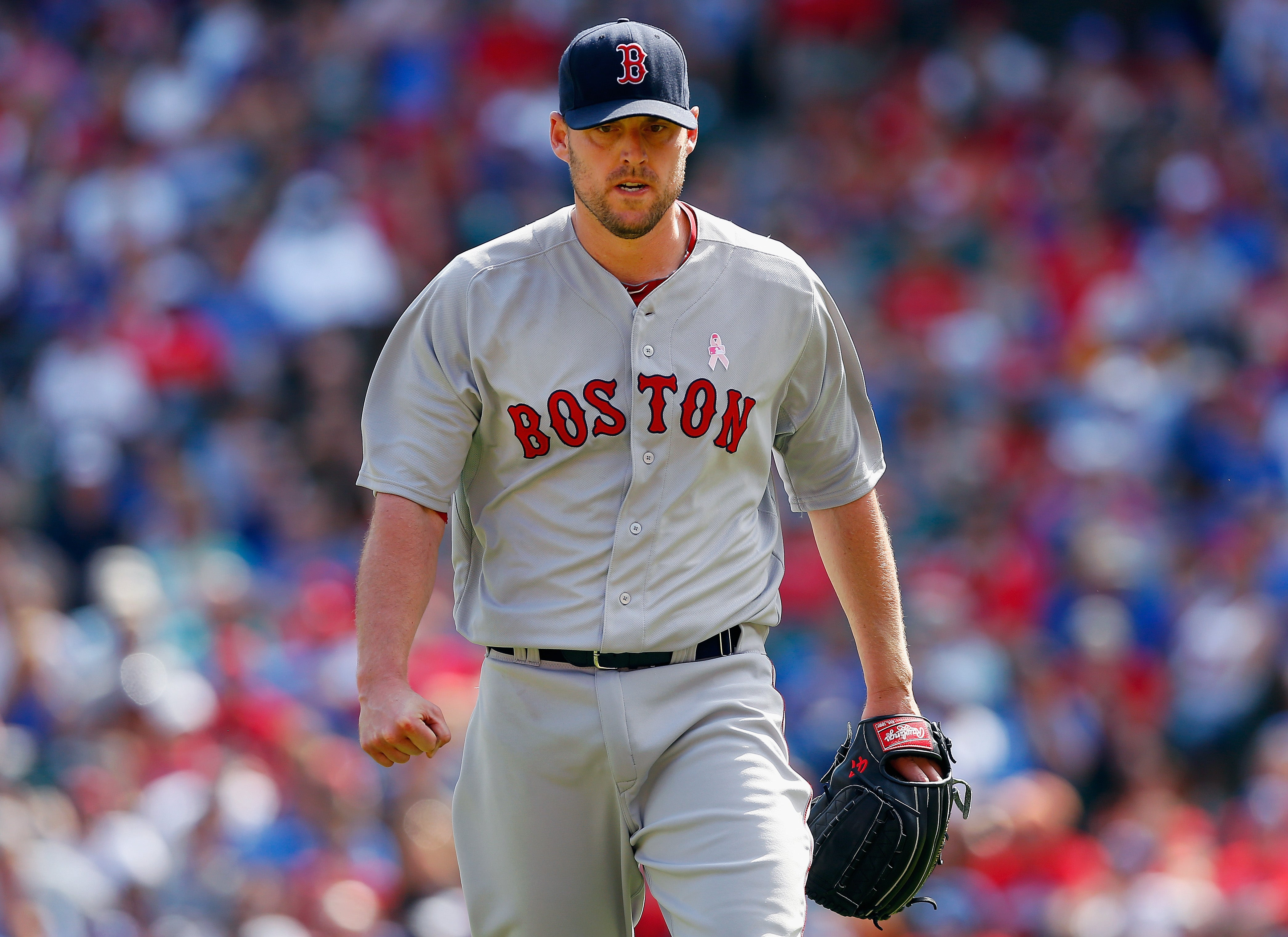 John Lackey had his ups and downs with the Red Sox, but ultimately gained redemption with his performance in the 2013 postseason.