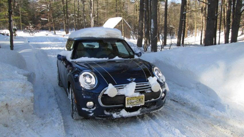 three small cars navigate a big winter. Black Bedroom Furniture Sets. Home Design Ideas