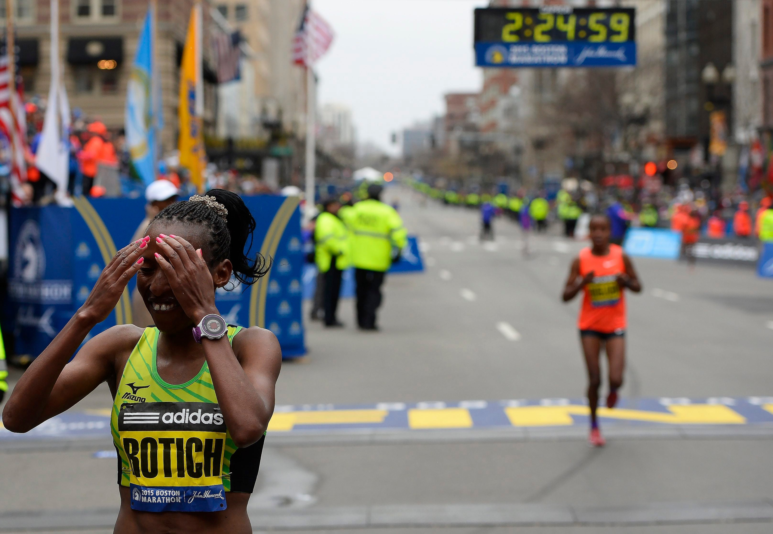 Caroline Rotich of Kenya reacts after winning the women's division.