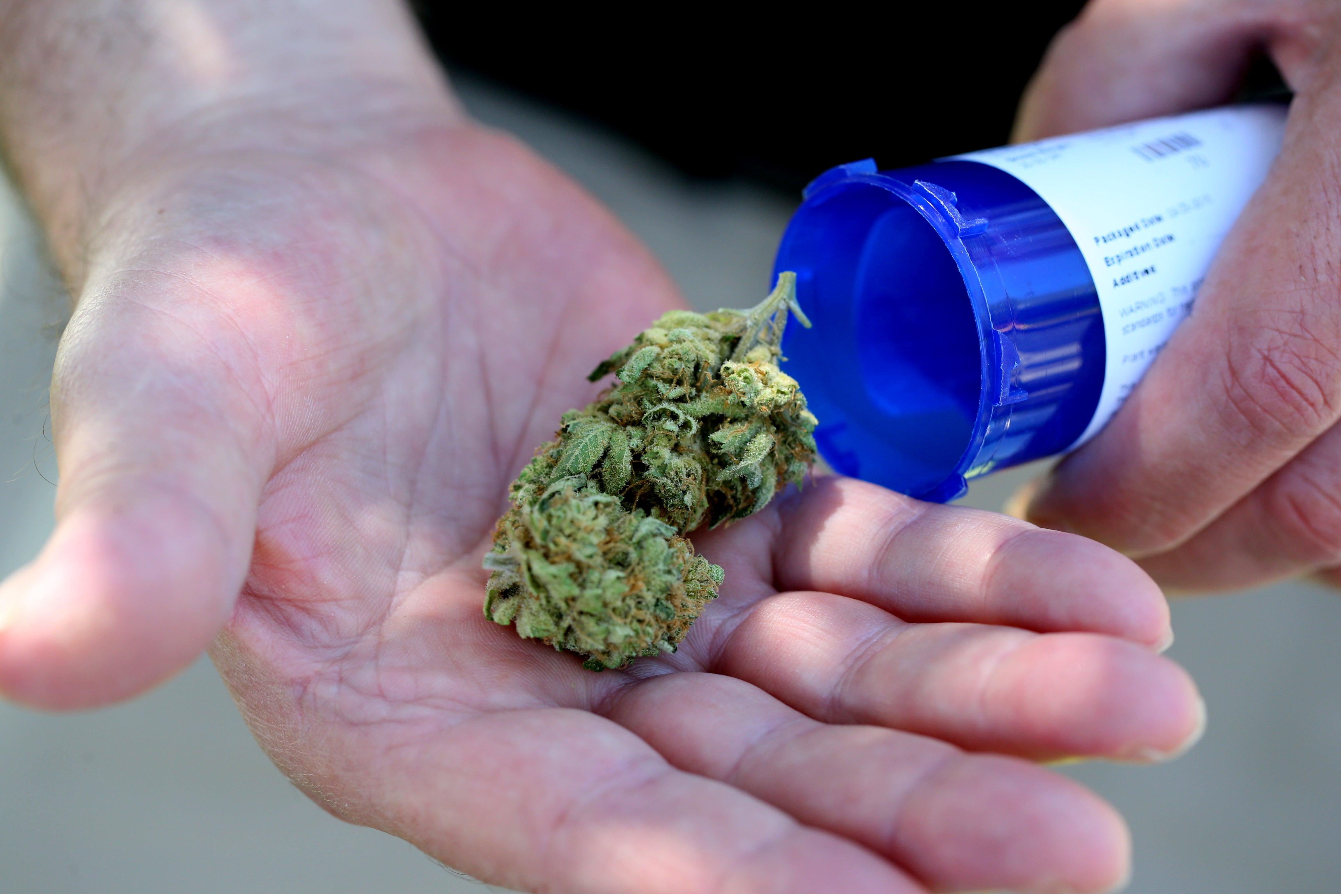 A Massachusetts patient shows off his medical marijuana.