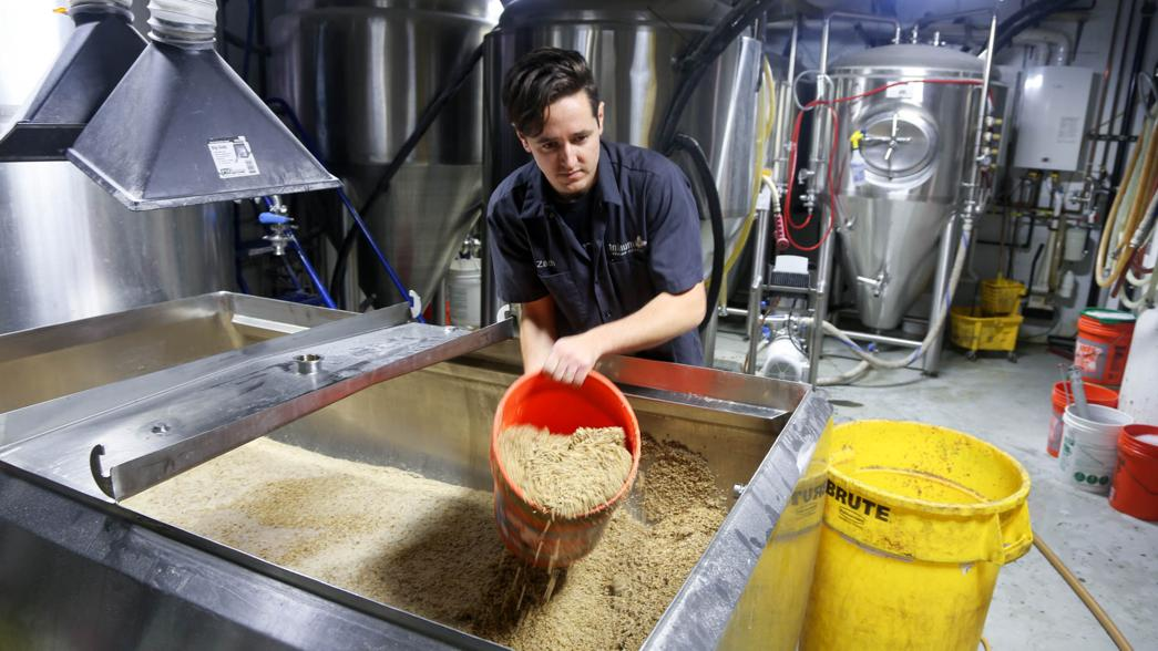Page hauls 50 pound bags of grain into Trillium regularly.