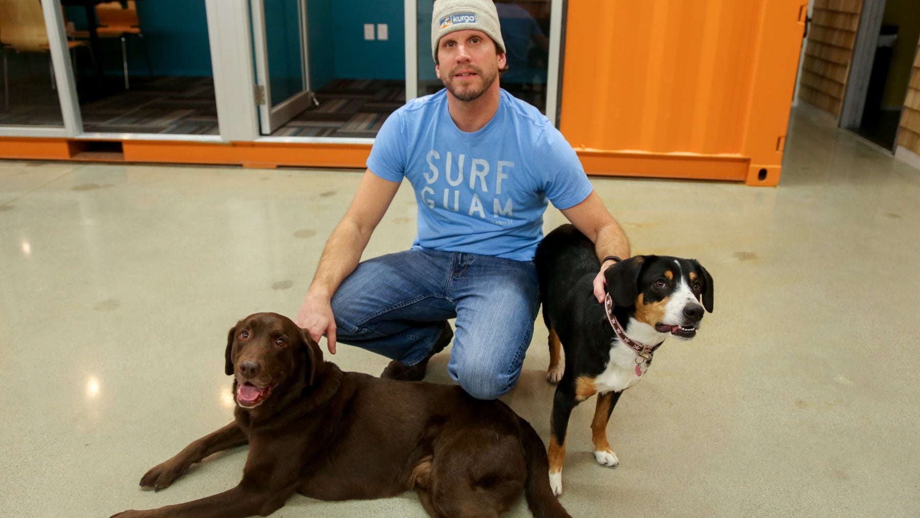 Brett Tetley, art director at Kurgo, and his dogs, Guinness and Dora.