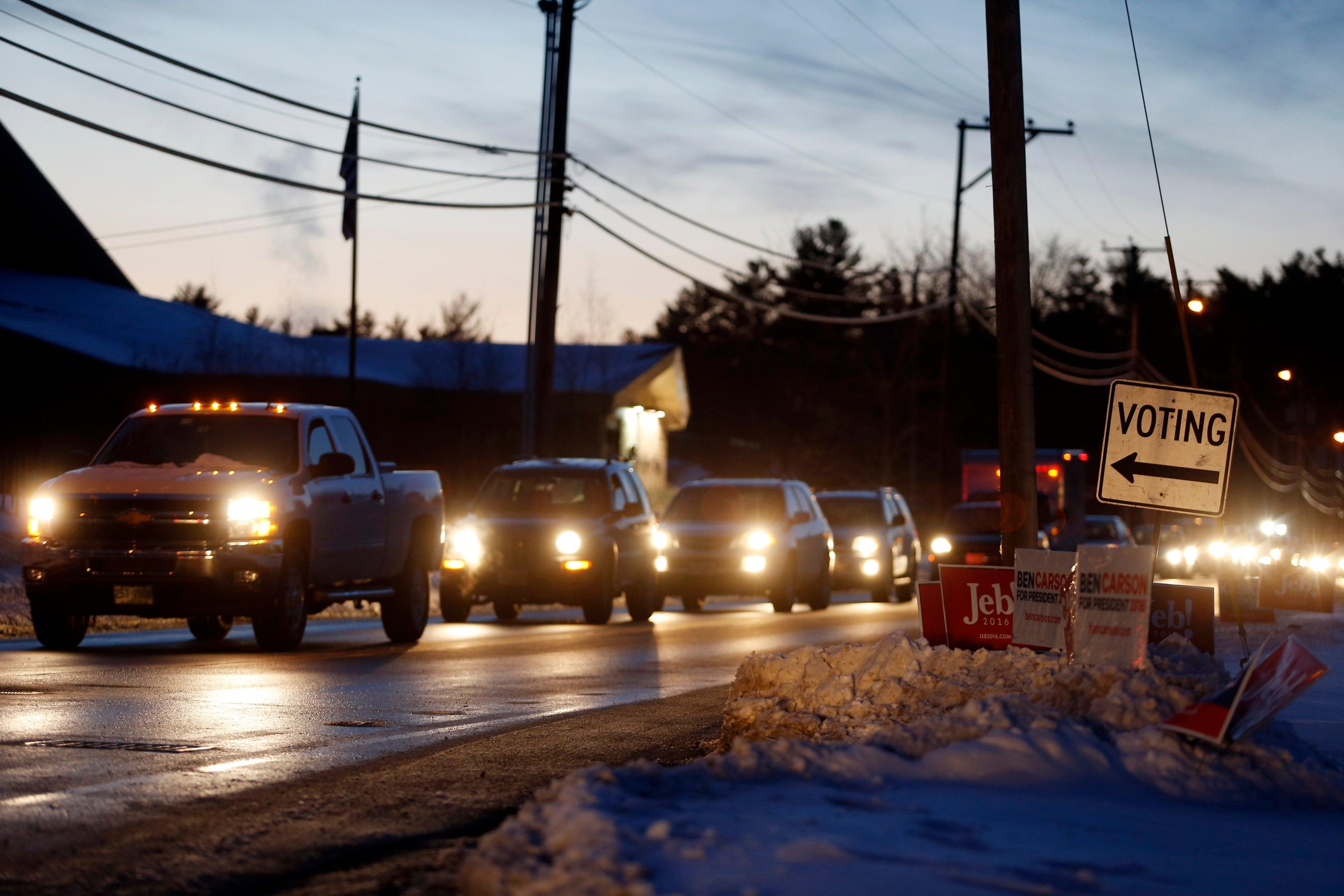 Voters wait in a miles long line of traffic to vote in Merrimack, N.H.