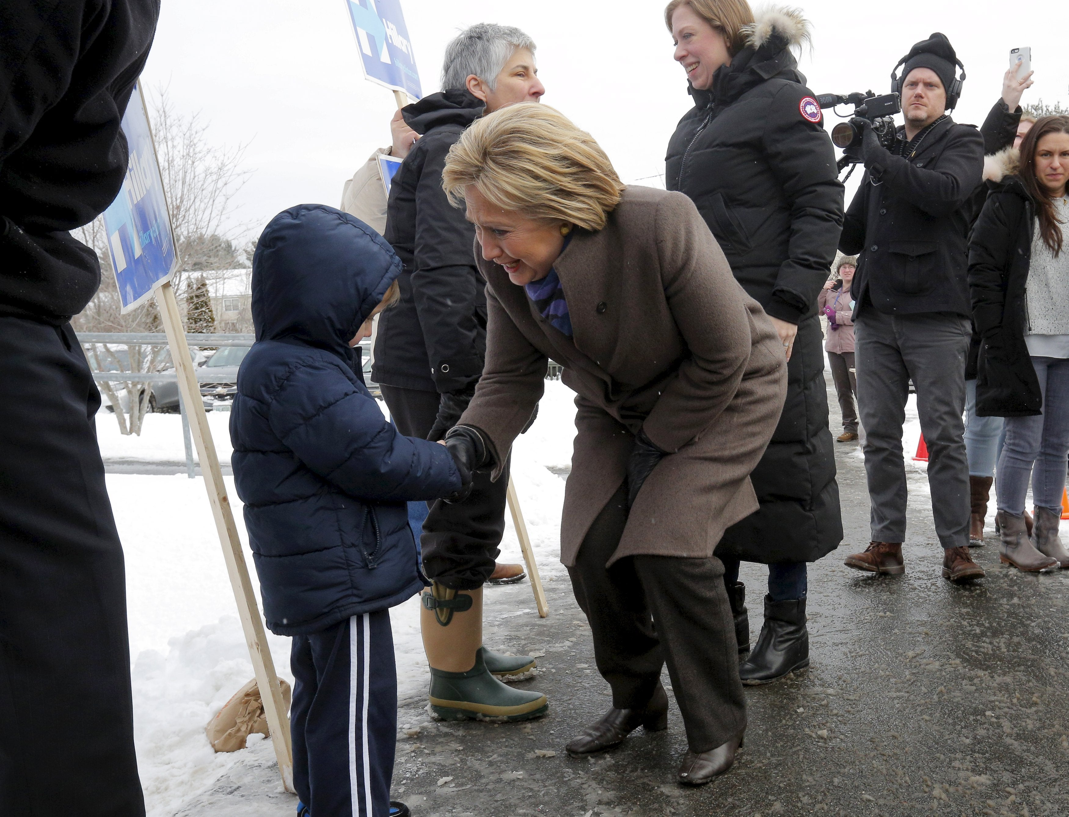 Clinton greets supporters outside a polling place in Derry, N.H.