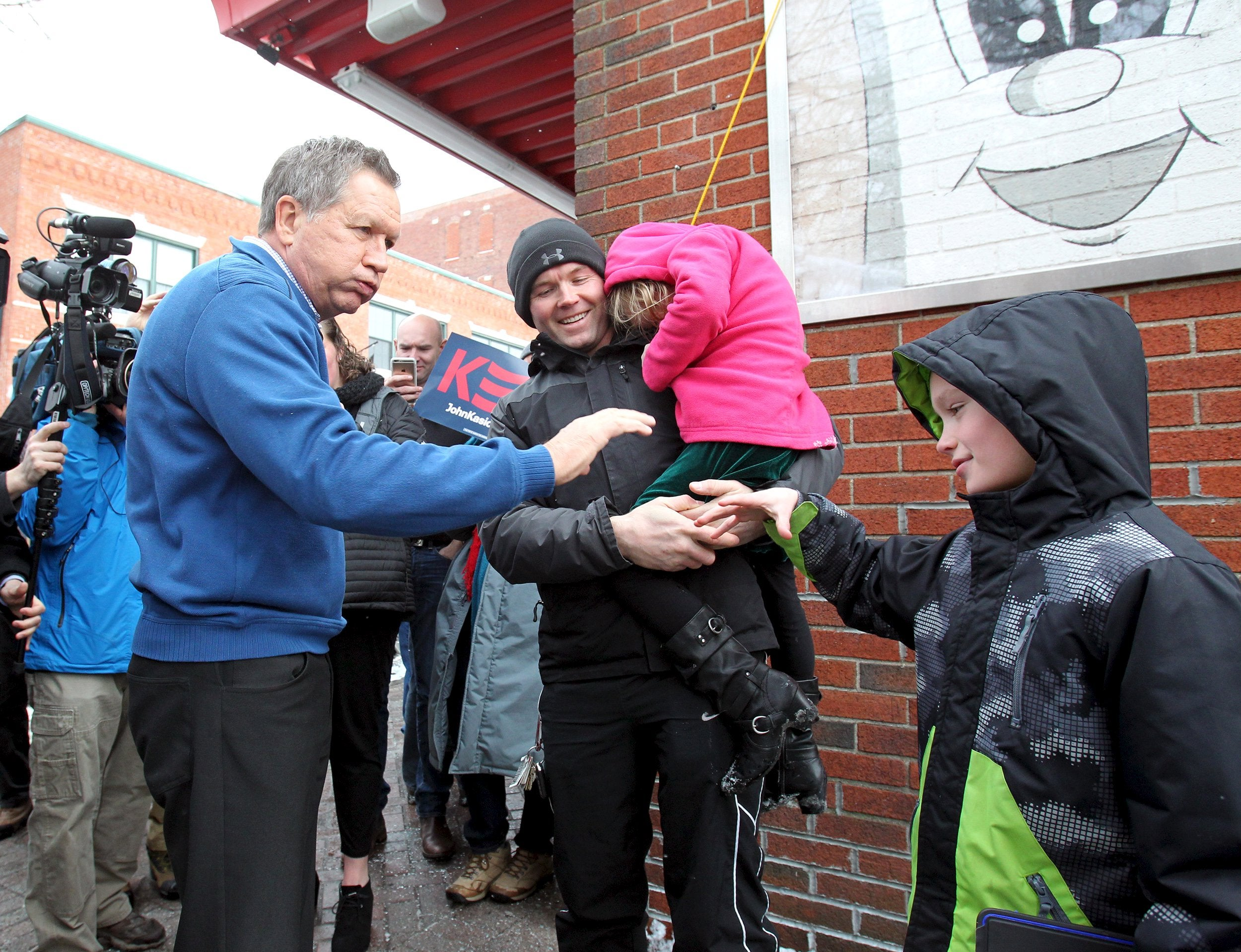 Kasich bumps fists with Cameron Patronick, 8, of Nashua, New Hampshire.