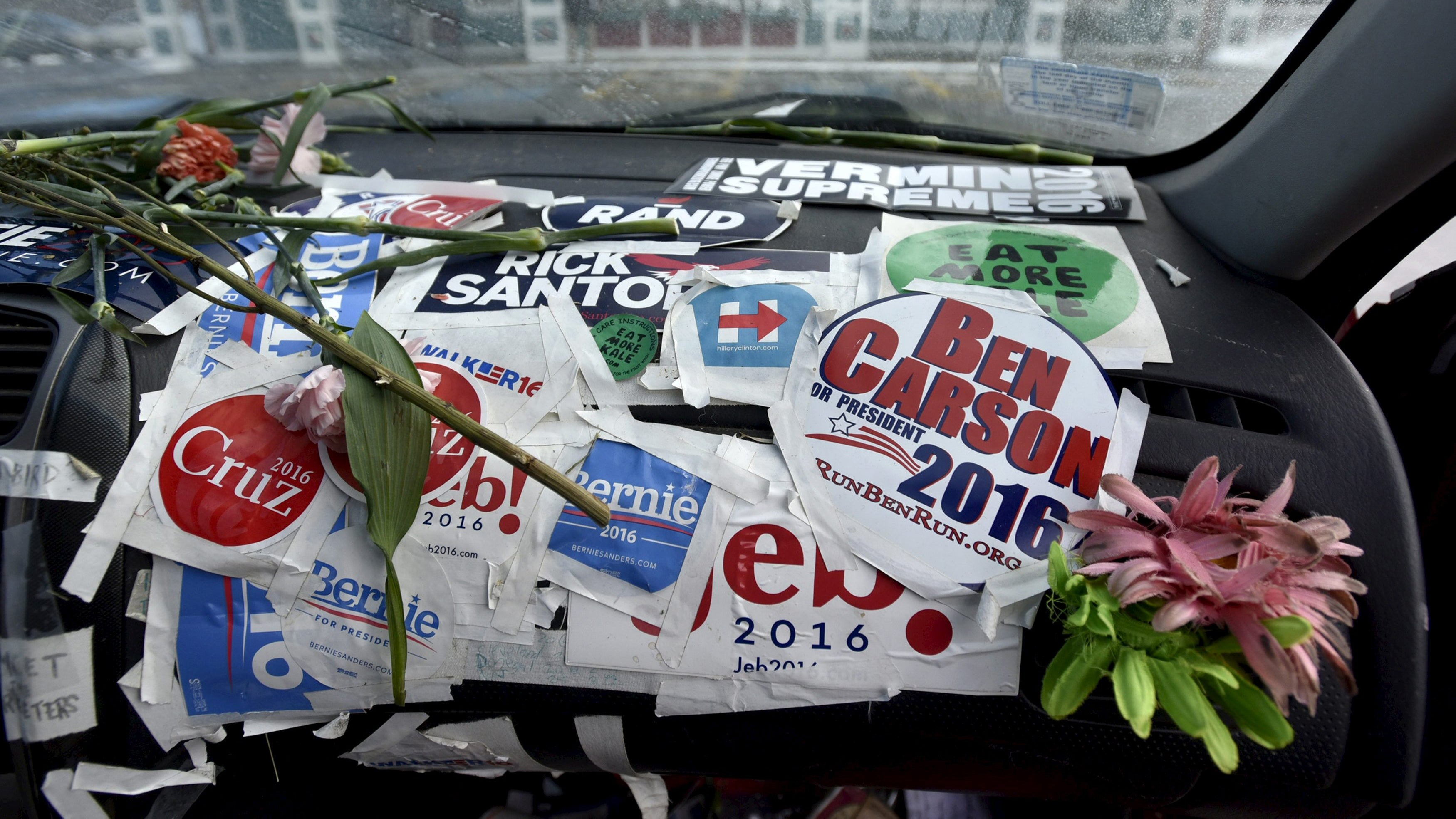 The dashboard of a car at T-Bones Great American Eatery in Derry, New Hampshire is covered in campaign stickers.