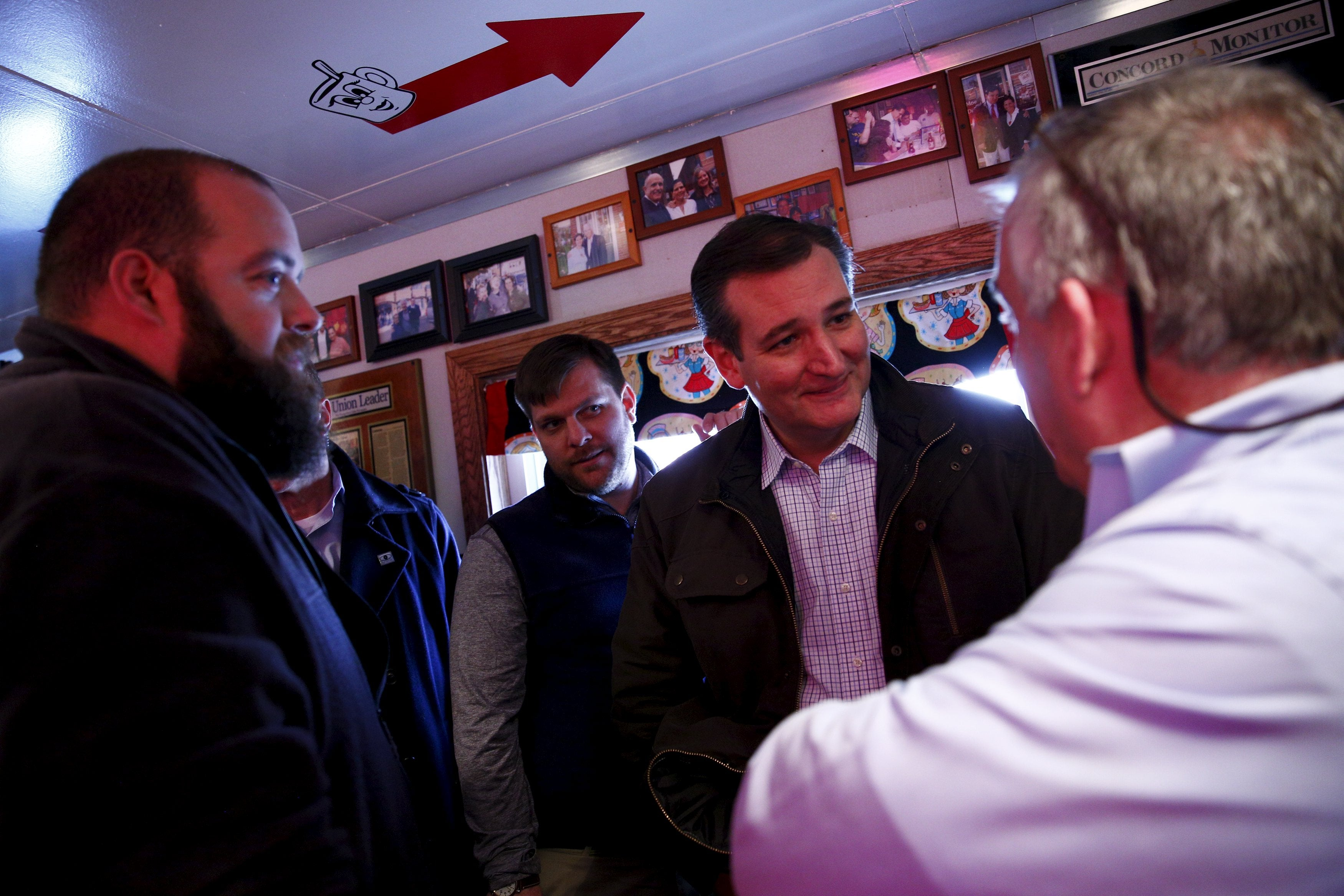 Republican presidential hopeful Ted Cruz greets a customer at the Red Arrow Diner in Manchester, New Hampshire.
