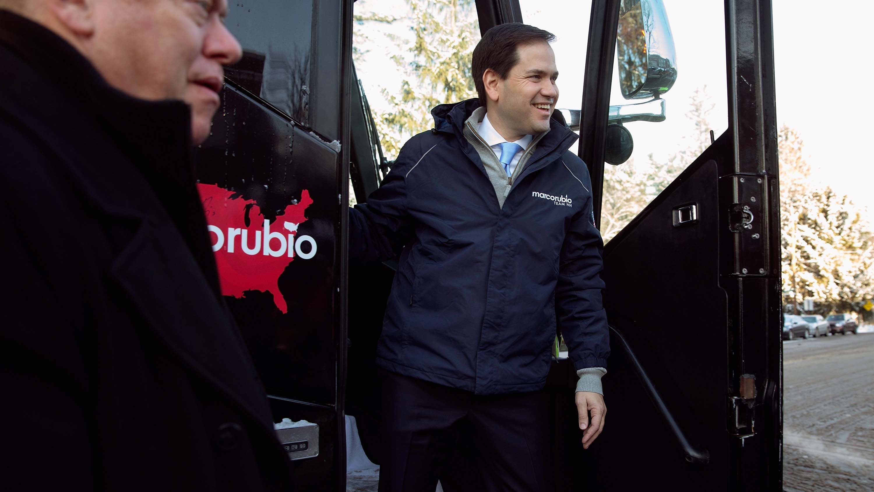 Republican presidential candidate Sen. Marco Rubio (R-FL) steps off his campaign bus outside the polling place at Webster School to thank supporters in Manchester, New Hampshire.