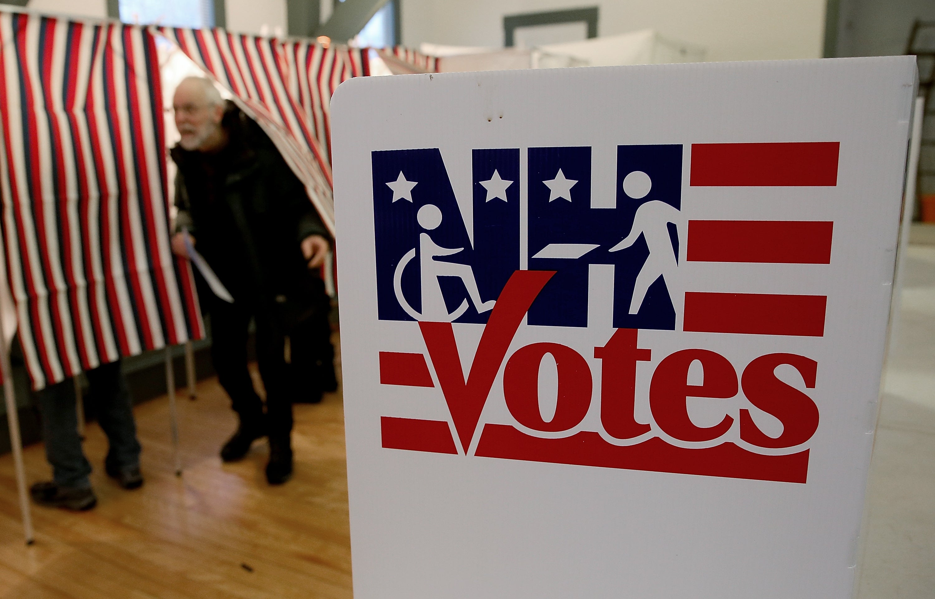 A voter leaves the a voting booth at the Canterbury Town Hall after casting his ballot.