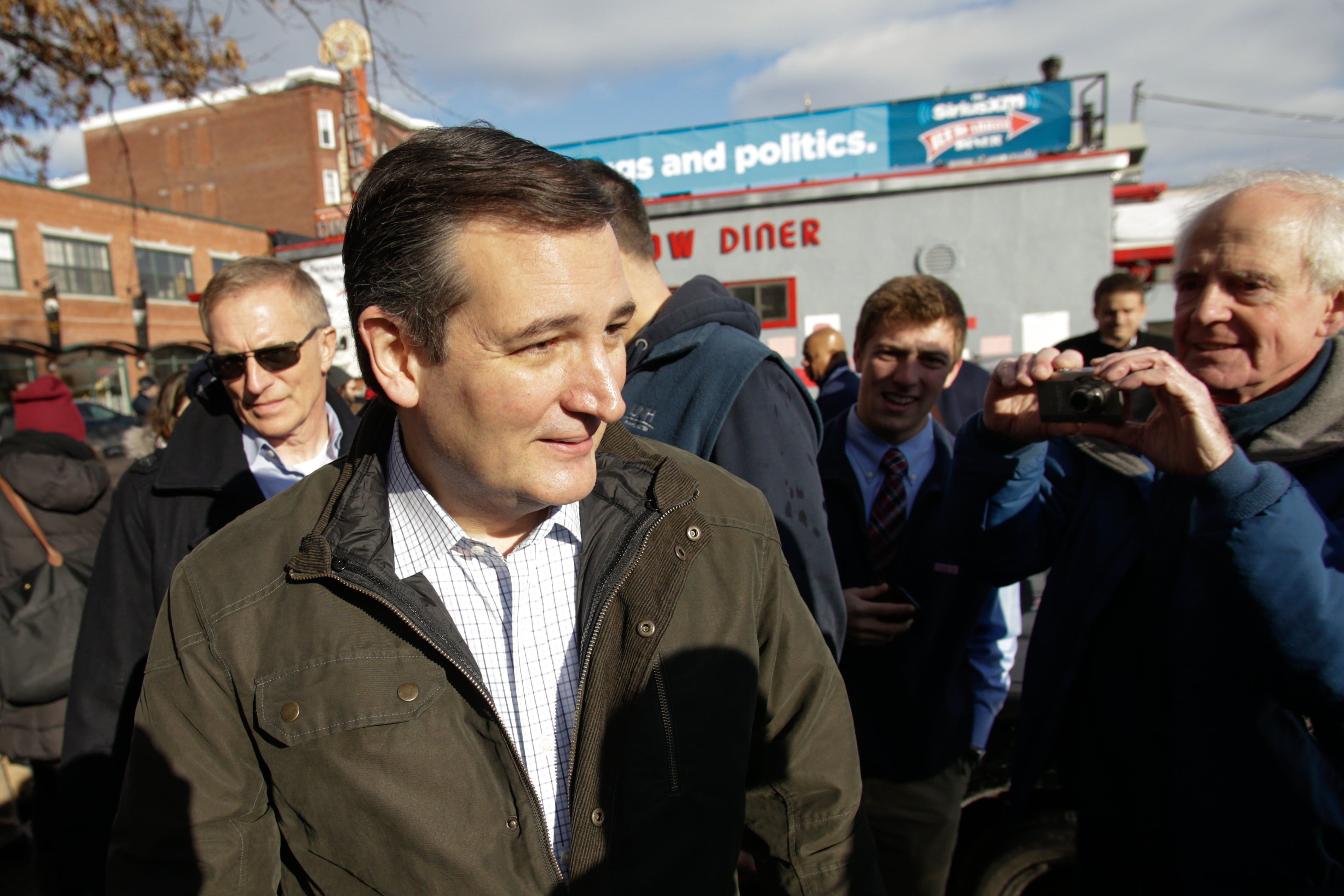 Cruz leaves a campaign stop at the Red Arrow Diner in Manchester, New Hampshire.
