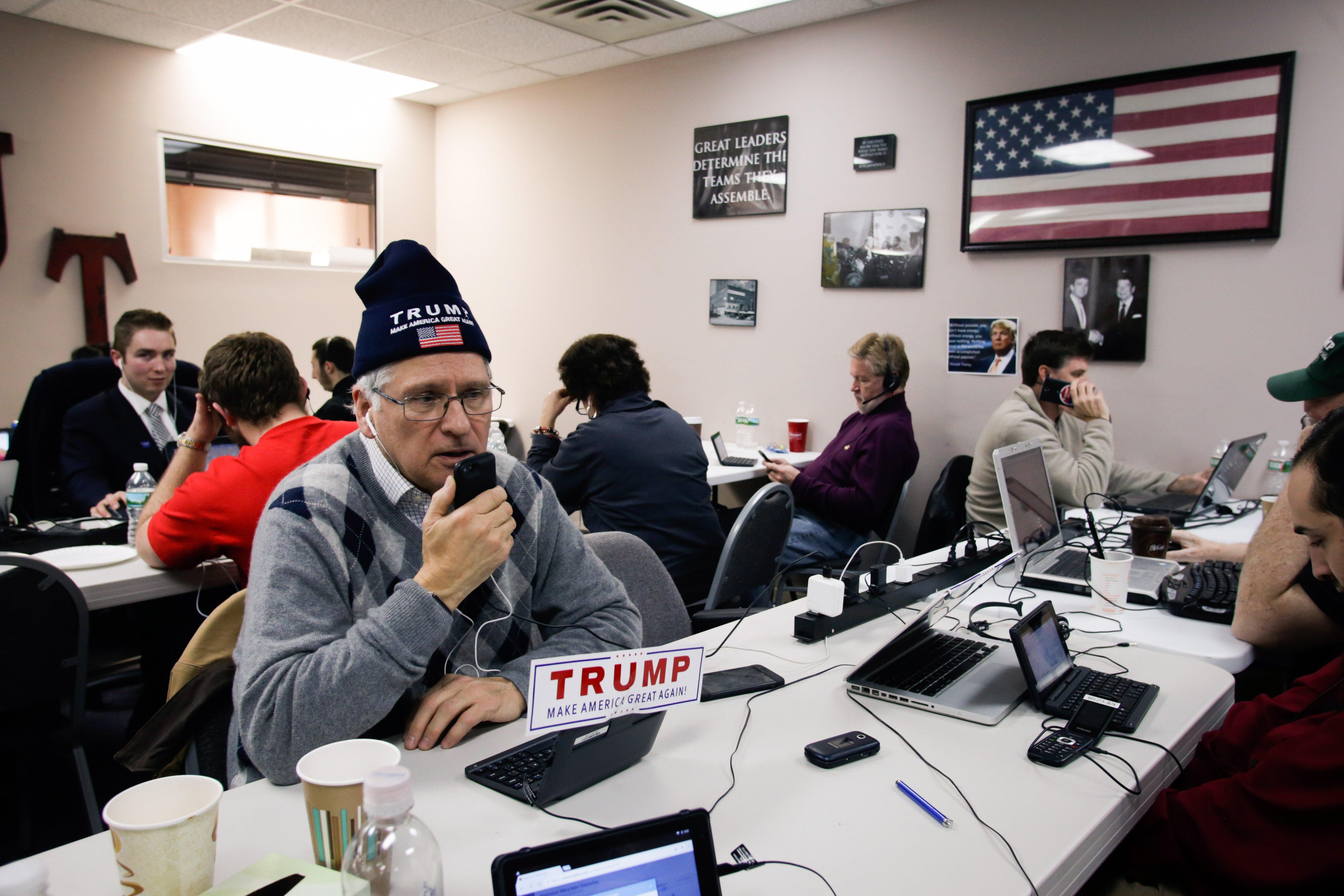 Cesare Del Vaglio, a campaign volunteer for Donald Trump, makes phone calls to New Hampshire voters at Trump's campaign office.