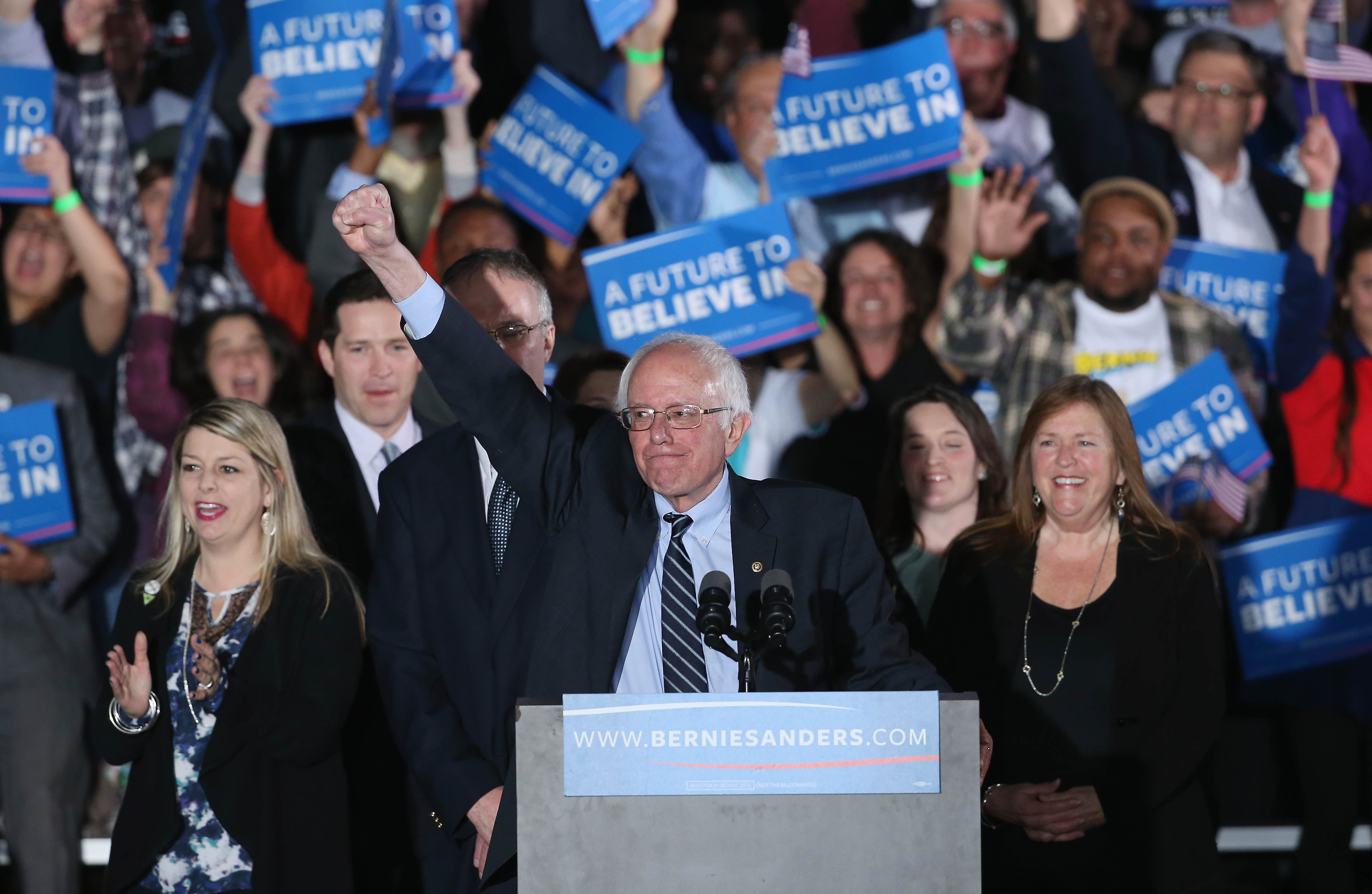 Sanders and his wife Jane O'Meara greet supporters after winning the New Hampshire Democratic Primary.