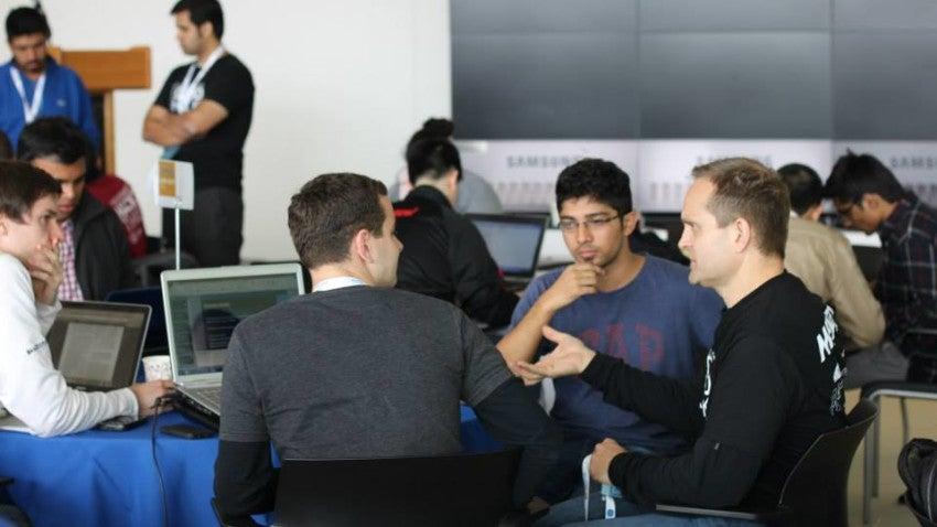Dr. Kristian Olson mentoring at a CAMTech hack-a-thon.