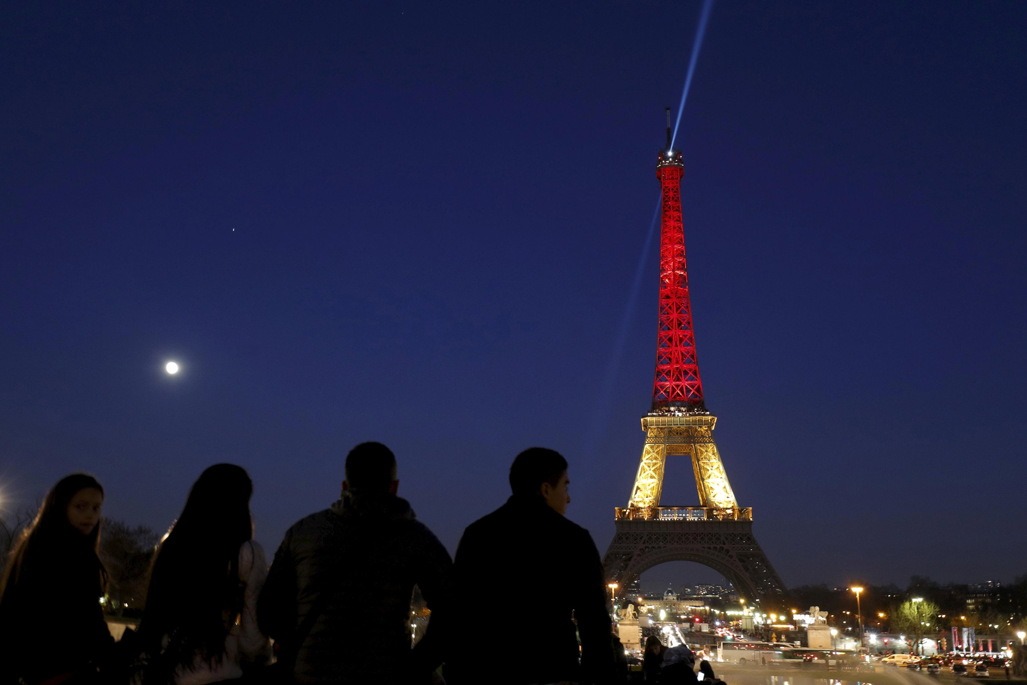 BELGIAN FLAG GALLERY The Eiffel Tower is seen with the black, yellow and red colours of the Belgian flag in tribute to the victims of today's Brussels bomb attacks, in Paris, France, March 22, 2016. REUTERS/Philippe Wojazer TPX IMAGES OF THE DAY