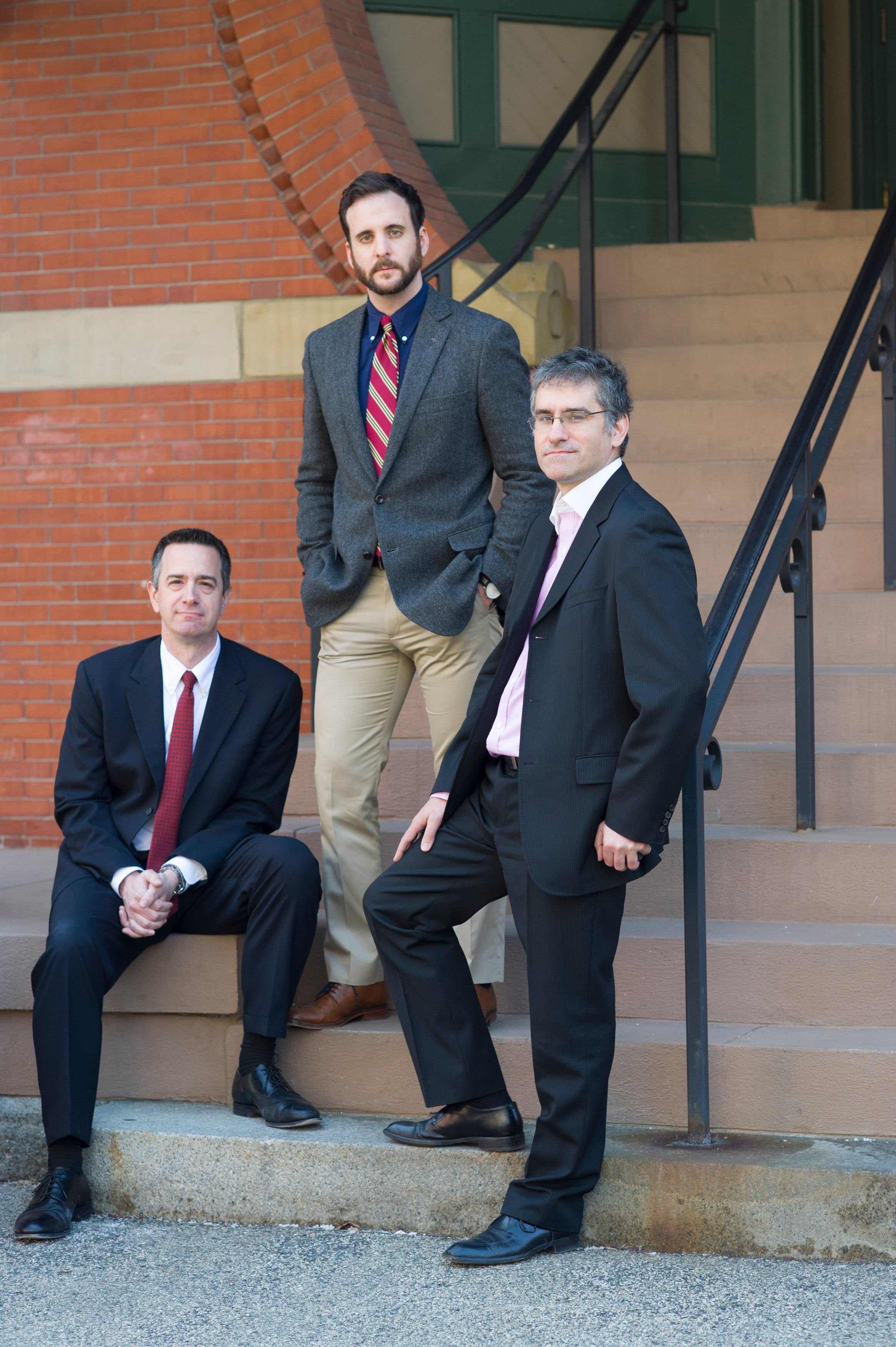 From left: Michael McClean, Philip Montenigro and Yorghos Tripodis, all of Boston University, who are among those studying the relationship between contact sports and the risk of memory or mood problems later in life, in Boston, March 27, 2016. Some scientists studying the relationship between contact sports and the risk of memory problems, including the Boston University group, argue that exposure to hits that snap the head — not concussions — is the most important factor. (Gretchen Ertl/The New York Times)