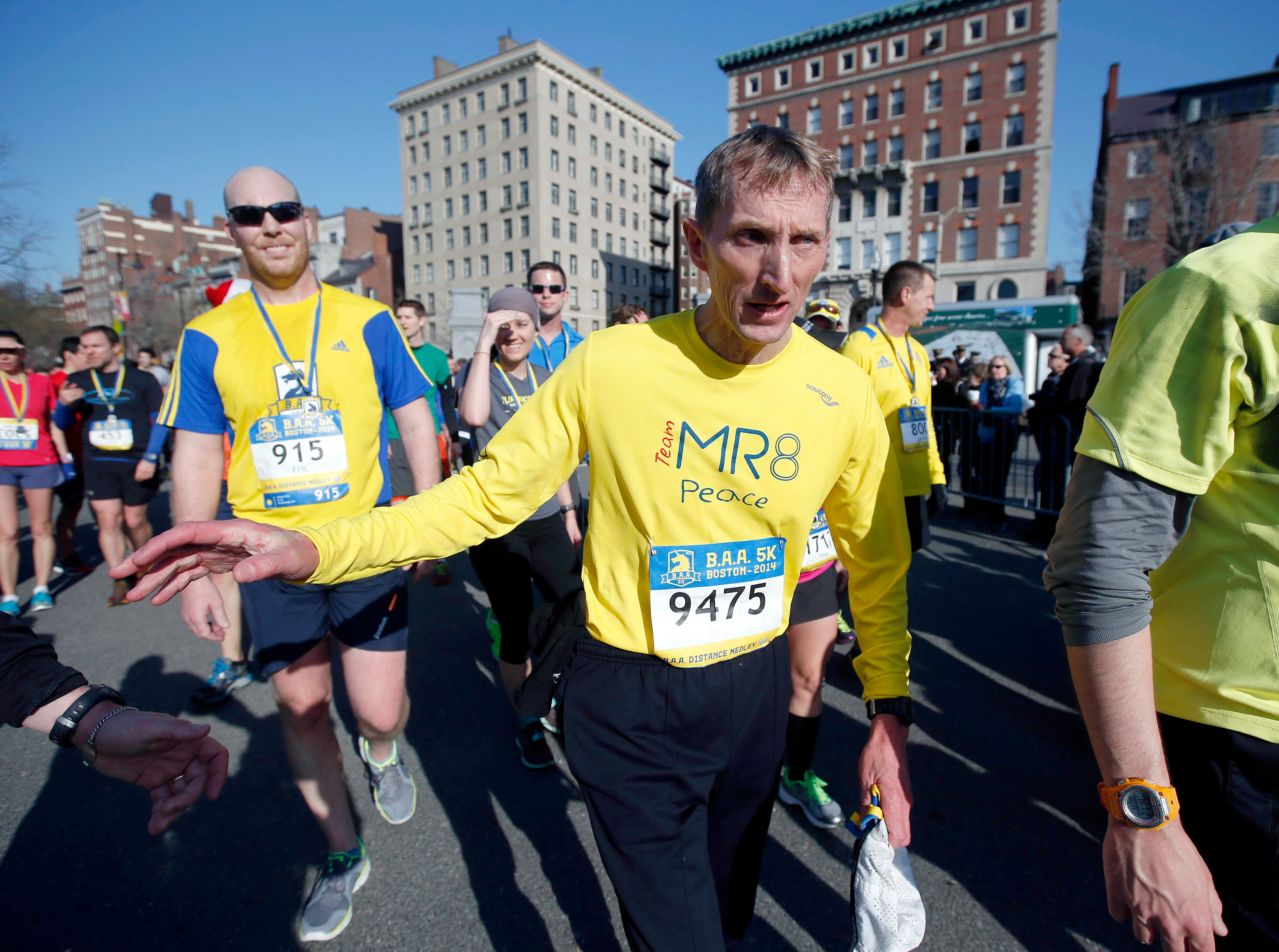 FILE - In this Saturday April 19, 2014 file photo, Boston Police Commissioner William Evans leaves the course after running in the 5-kilometer race in Boston. The recent bombing in Brussels has heightened security concerns for this year's Boston Marathon. Evans, who is an accomplished athlete, said he will sit out the race because he says he's needed amid increased security following the attacks in Brussels. (AP Photo/Elise Amendola, File)