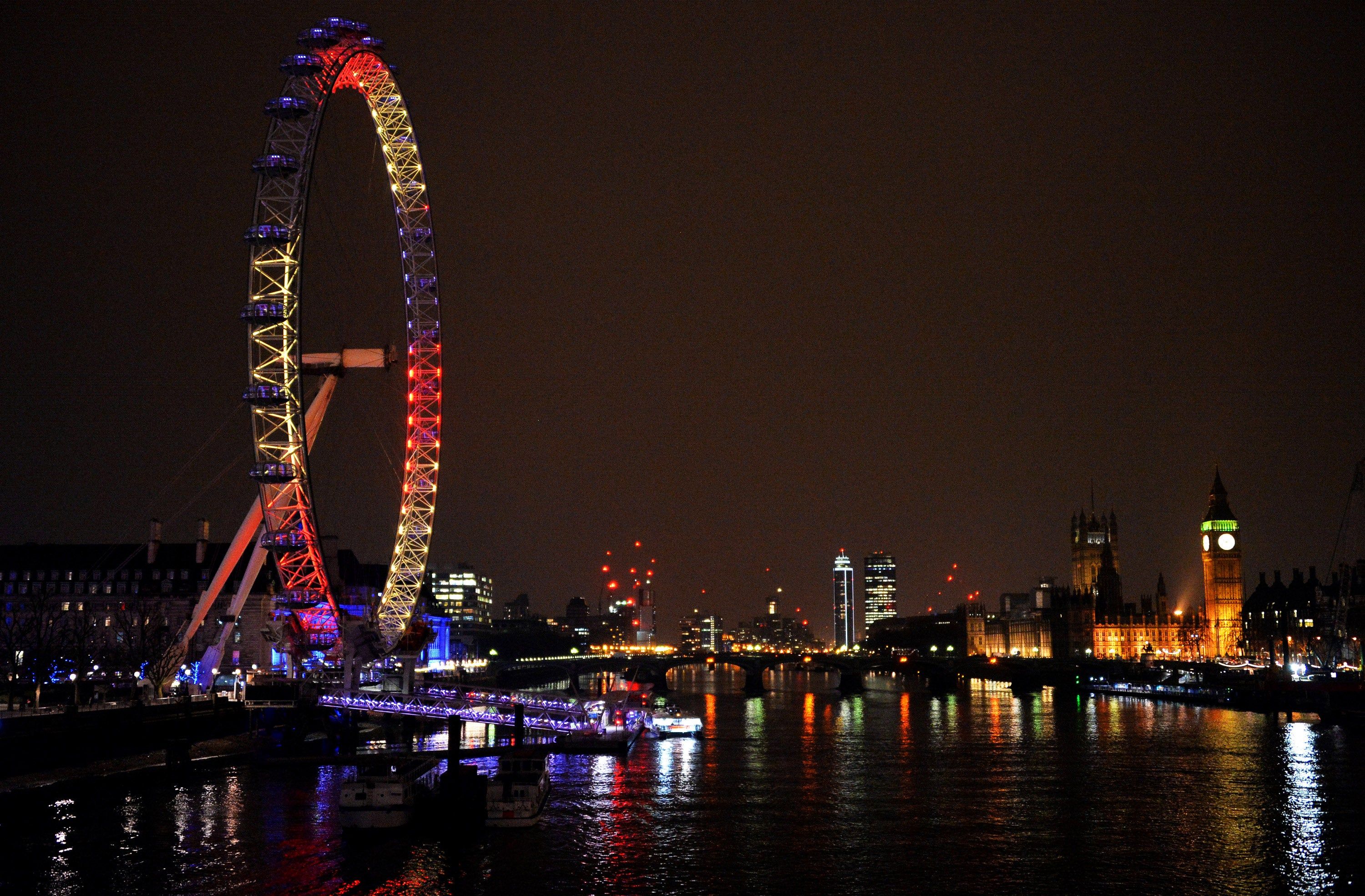 LONDON, ENGLAND - MARCH 23: The London Eye, one of many London landmarks which have been lit up in support of Belgium following the terrorist attacks in Brussels yesterday, on March 23, 2016 in London, England. Belgium is observing three days of national mourning after 34 people were killed in a twin suicide blast at Zaventem Airport and a further bomb attack at Maelbeek Metro Station. Two brothers are thought to have carried out the airport attack and an international manhunt is underway for a third suspect. The attacks come just days after a key suspect in the Paris attacks, Salah Abdeslam, was captured in Brussels. (Photo by Anthony Harvey/Getty Images)