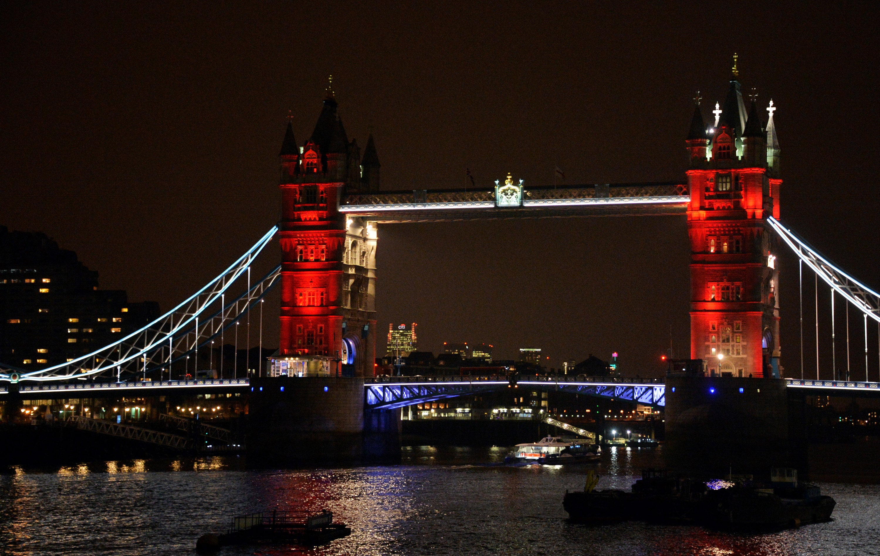 LONDON, ENGLAND - MARCH 23: London Bridge, one of many London landmarks which have been lit up in support of Belgium following the terrorist attacks in Brussels yesterday, on March 23, 2016 in London, England. Belgium is observing three days of national mourning after 34 people were killed in a twin suicide blast at Zaventem Airport and a further bomb attack at Maelbeek Metro Station. Two brothers are thought to have carried out the airport attack and an international manhunt is underway for a third suspect. The attacks come just days after a key suspect in the Paris attacks, Salah Abdeslam, was captured in Brussels. (Photo by Anthony Harvey/Getty Images)