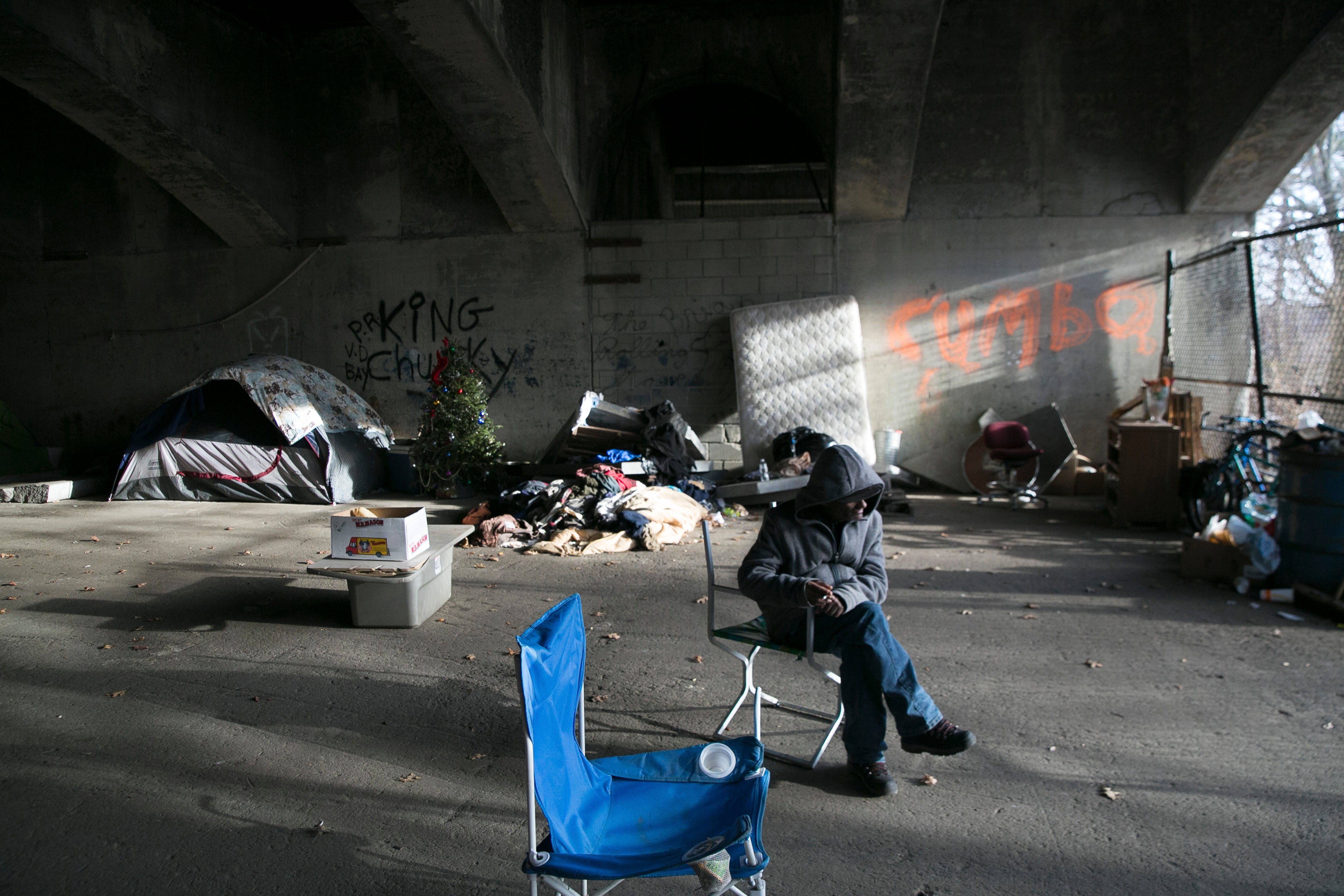 An addict at a homeless encampment in Lawrence.