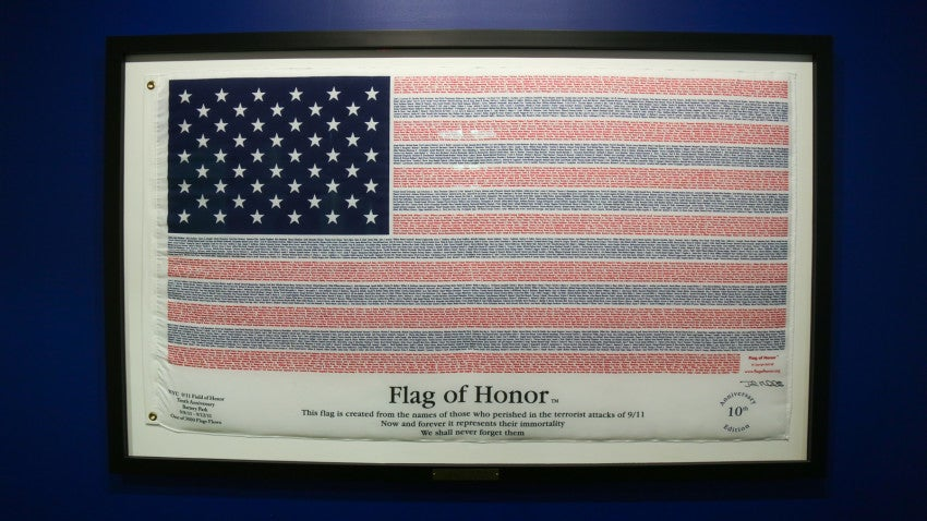 A flag remembering the victims of 9/11 hangs in the halls of Akamai's Cambridge offices.