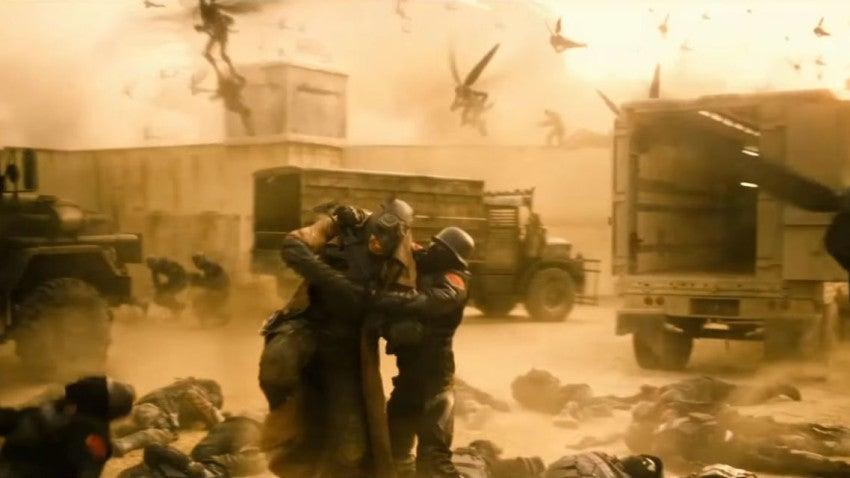Batman fights off adversaries in a scene from Batman v Superman.