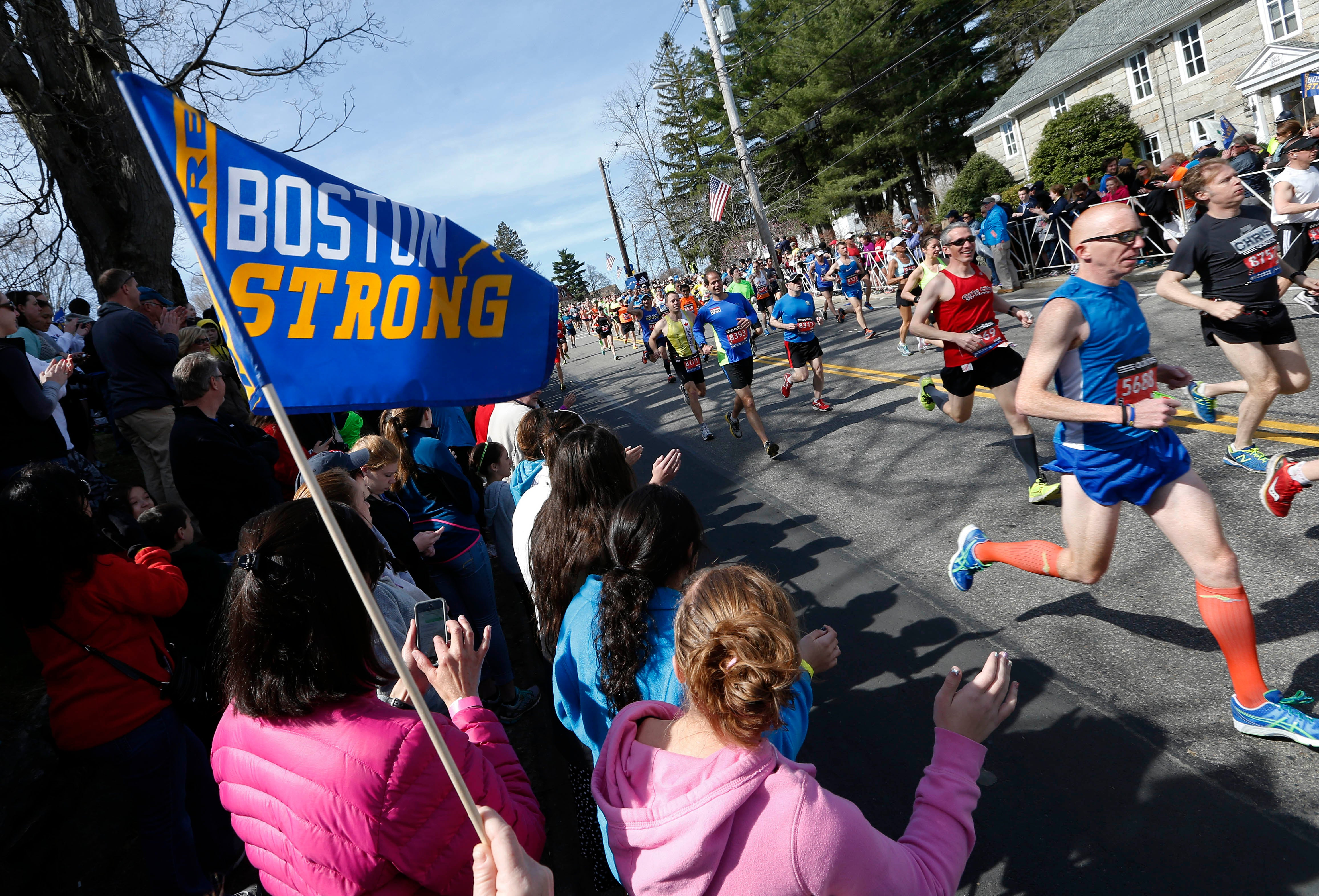 Race fans cheer runners as they start the 118th Boston Marathon Monday, April 21, 2014. in Hopkinton, Mass.