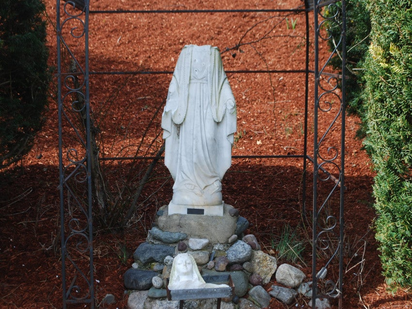 Vandalized statues at a Burlington church.