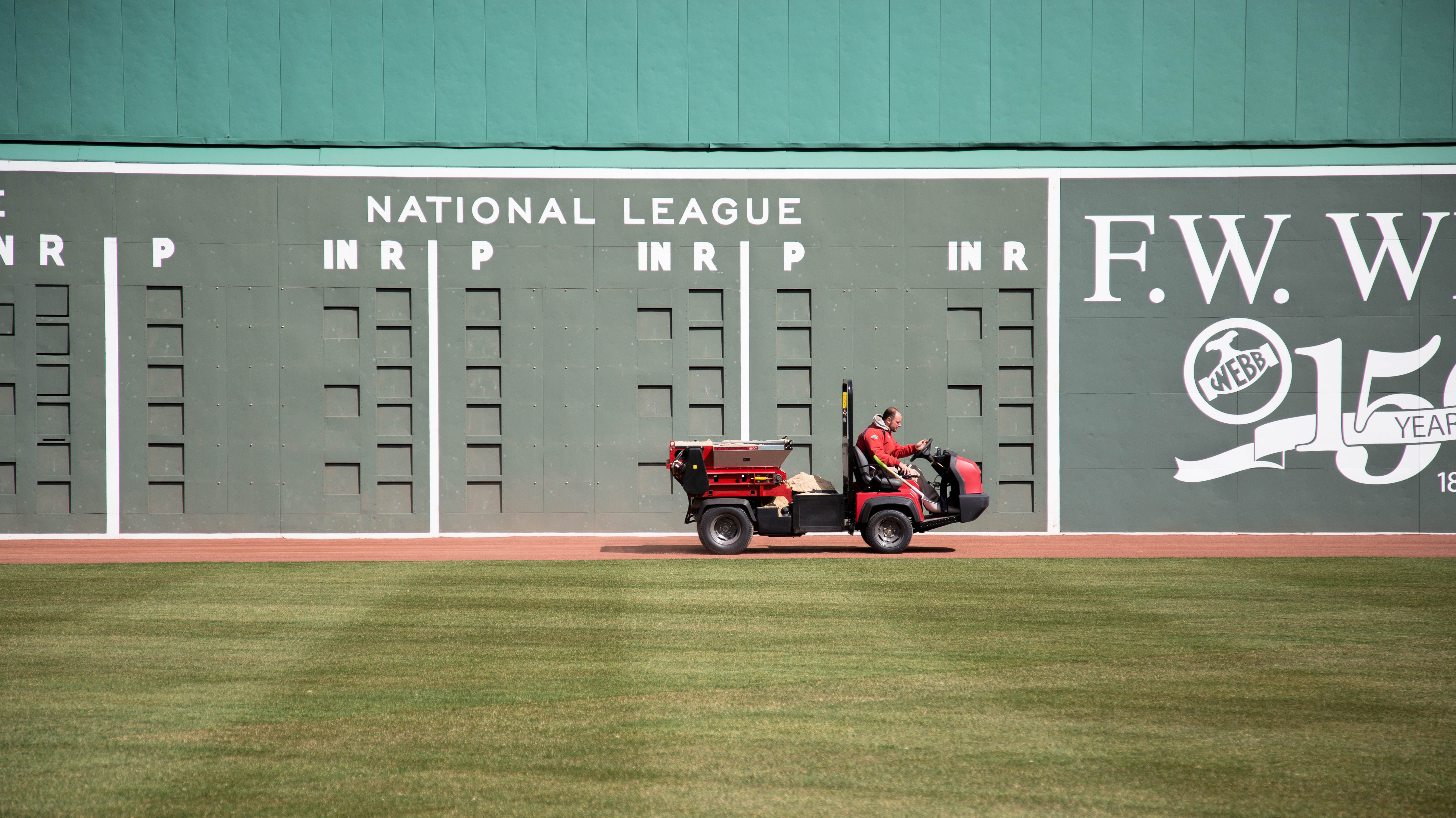 No scores, no standings -- not yet -- on Fenway's Green Monster as an employee drives past on the last day of March.
