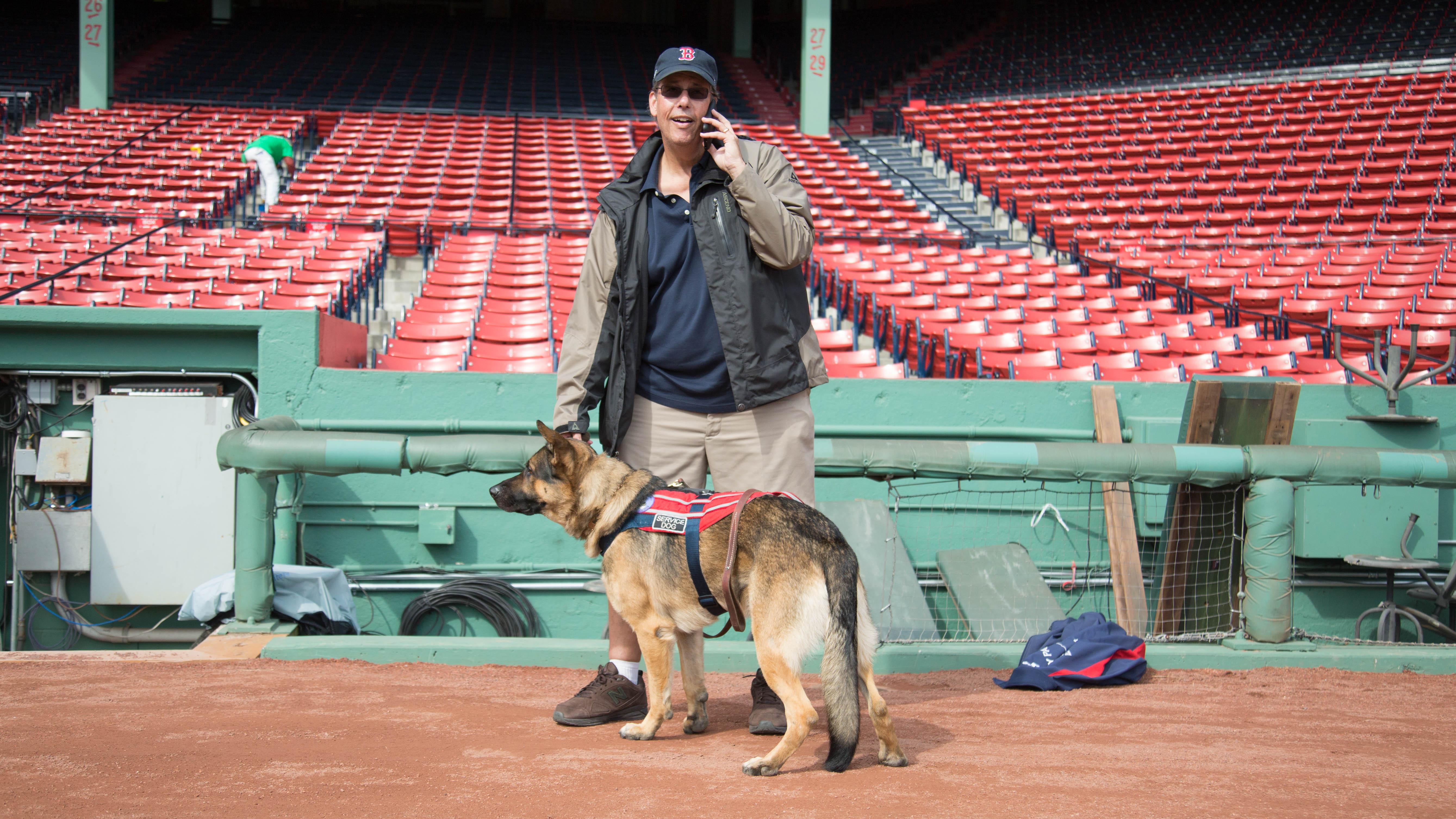 Mellor's service dog, Drago, is a constant companion.