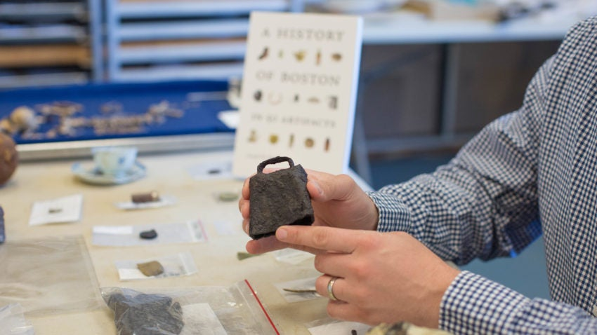 Bagley holds an 18th or early 19th century iron cowbell excavated on Boston Common by archaeologists in 1986.