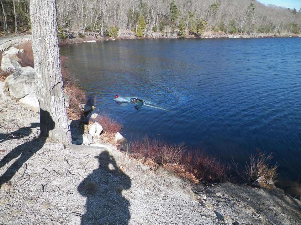 A car that veered off the road and into Fox Pond in Maine was almost fully submerged.