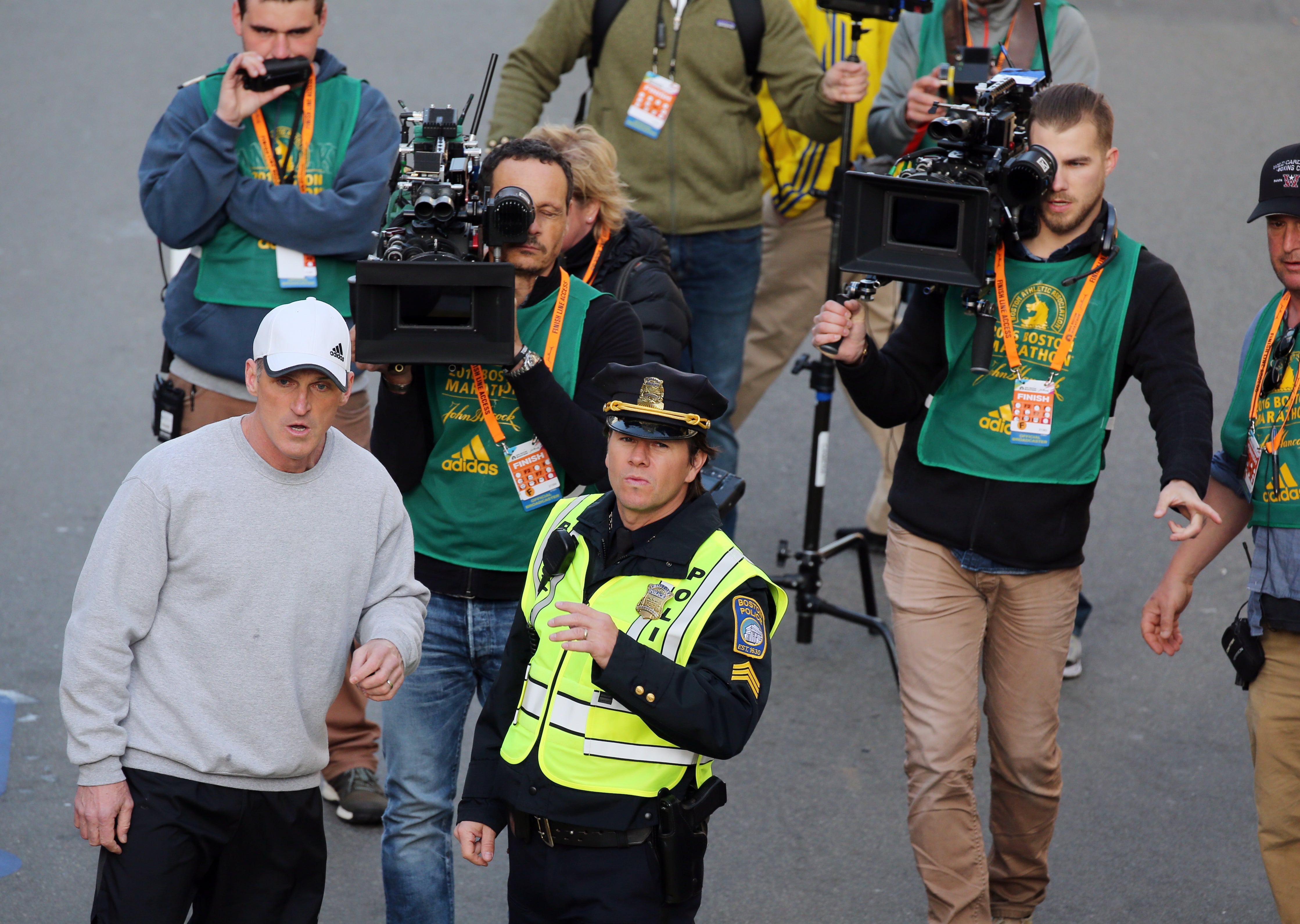 Mark Wahlberg filing a scene for Patriots Day at the finish line of the 120th Boston Marathon.