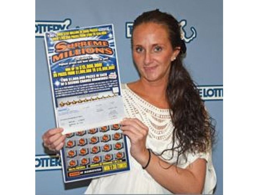 """Christine Bunszel of Marshfield claimed the second $15 million grand prize in the Massachusetts State Lottery's $30 """"Supreme Millions"""" instant game."""