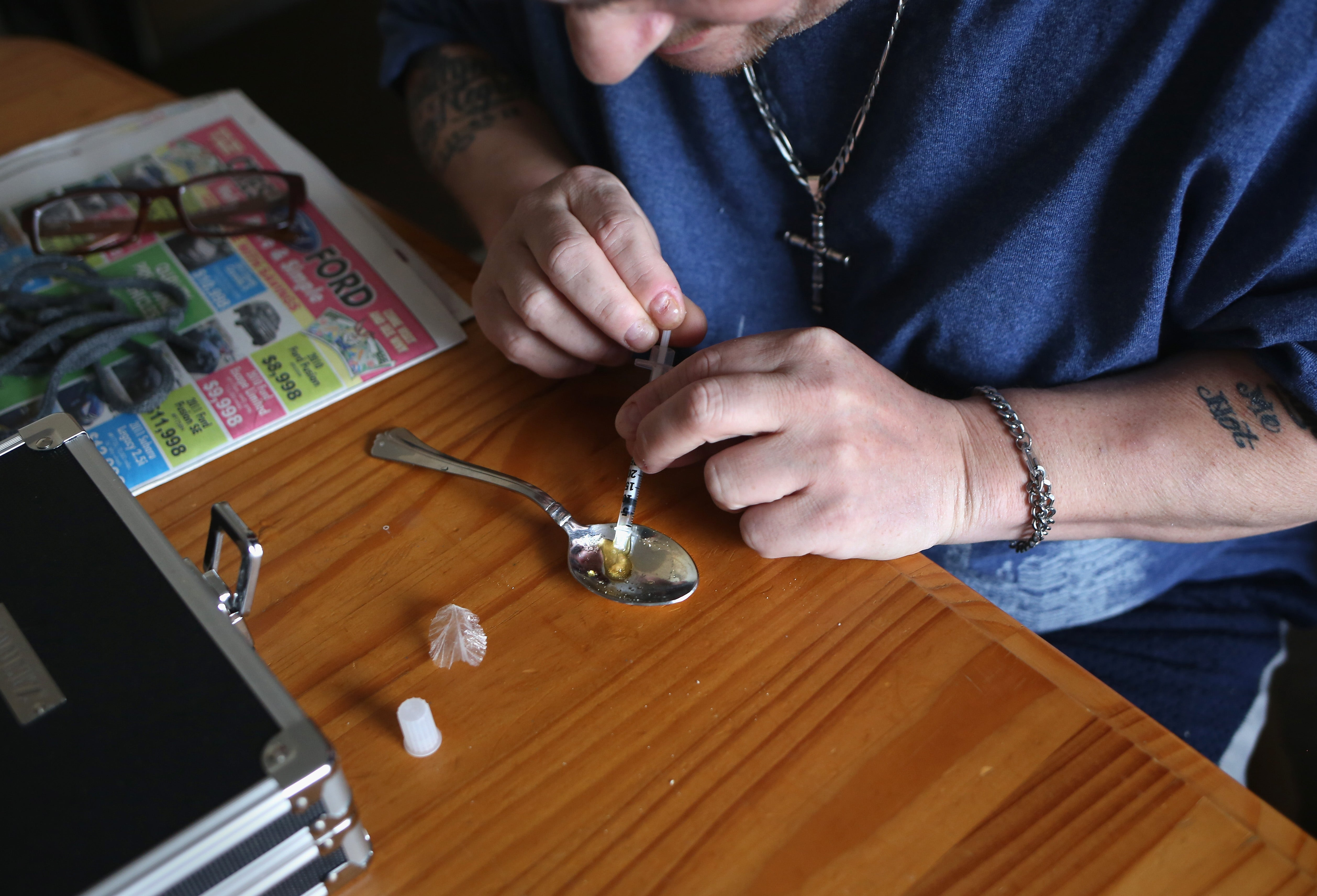 A man in New London, Conn., preparing to inject heroin last month. Supporters and opponents of marijuana legalization have cited the region's opioid crisis as part of their arguments.