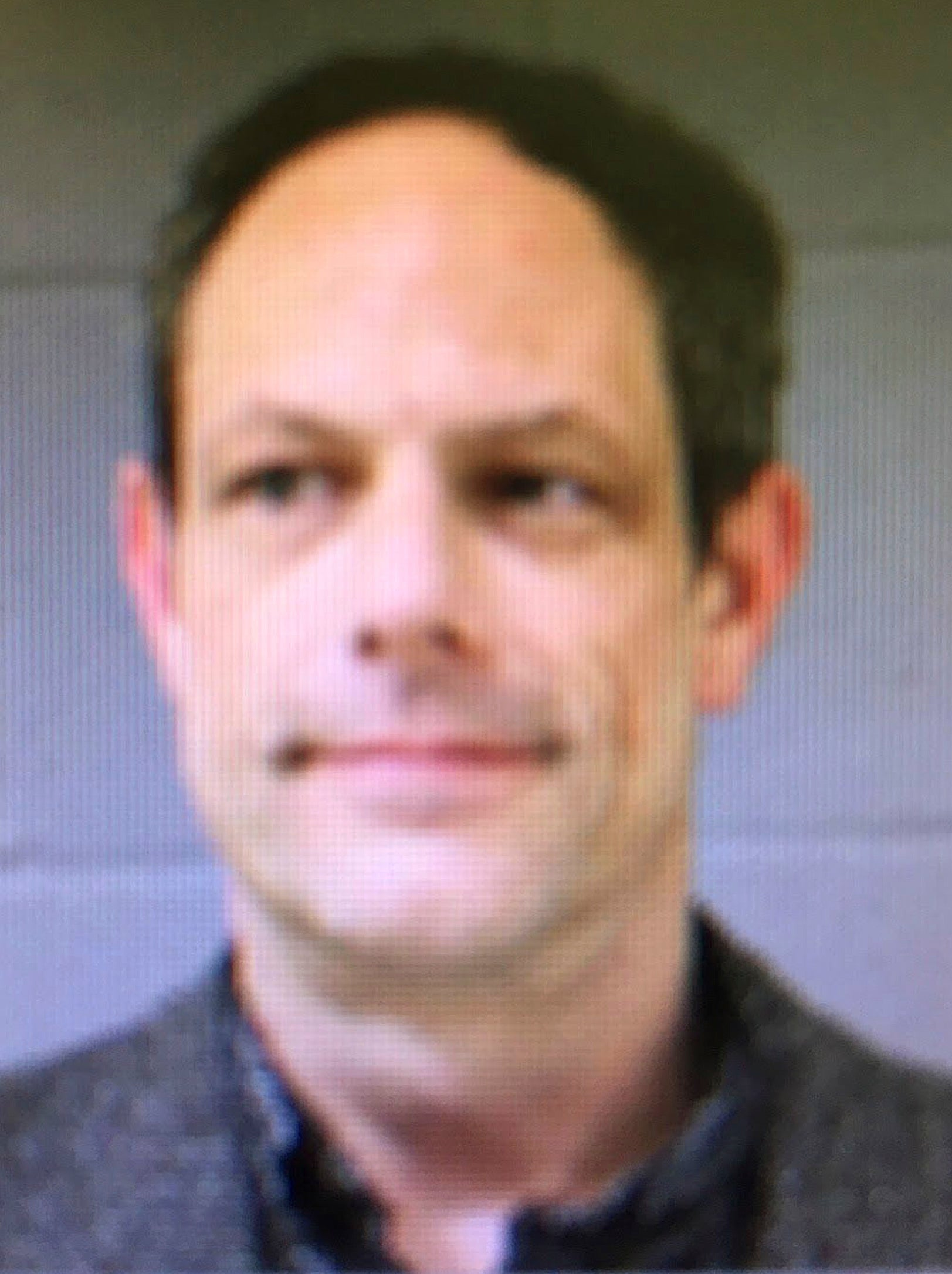 This booking photo released by the Newtown Police Department shows Jason Adams, arrested Wednesday, April 6, 2016, and charged with having a gun at the town's middle school. Adams, 46, a teacher at the school, was charged with possession of a weapon on school grounds, which is illegal in Connecticut. Police said he has a valid pistol permit. A gunman shot and killed 20 students and six educators at nearby Sandy Hook Elementary School in Newtown in December 2012. (Newtown Police Department via AP)
