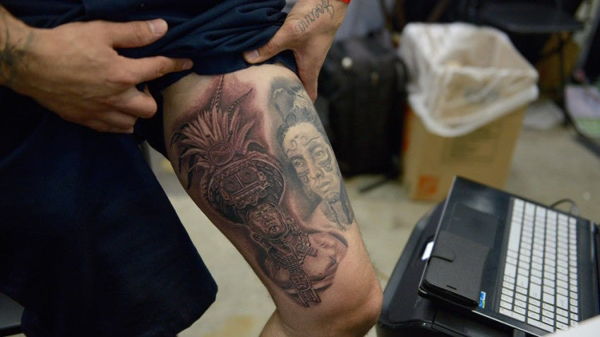 Gil Madrid of Blood, Ink & Tears shows off art on his leg.