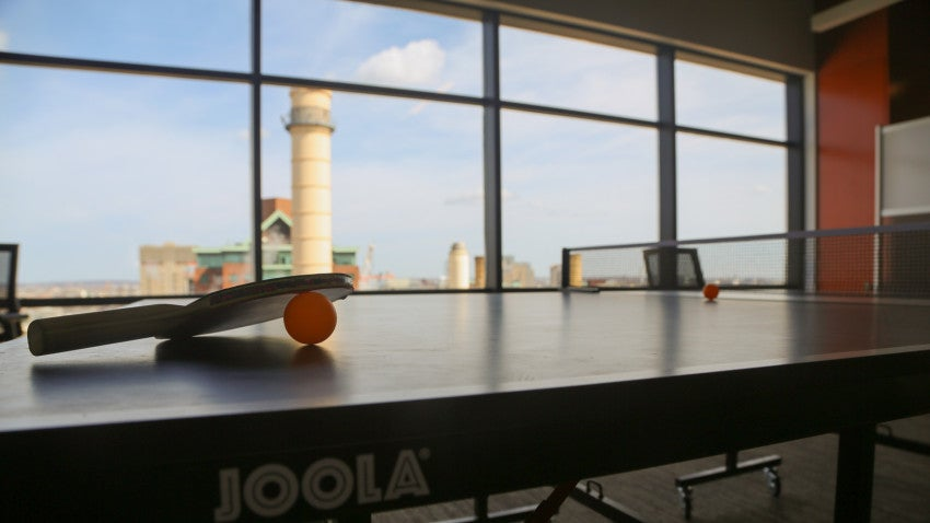 Rapid7 workers blow off steam with daily games of ping pong.