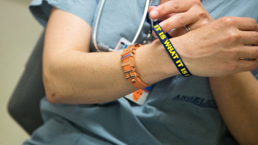 Mastrocola wears the bracelet a former cancer patient wore.